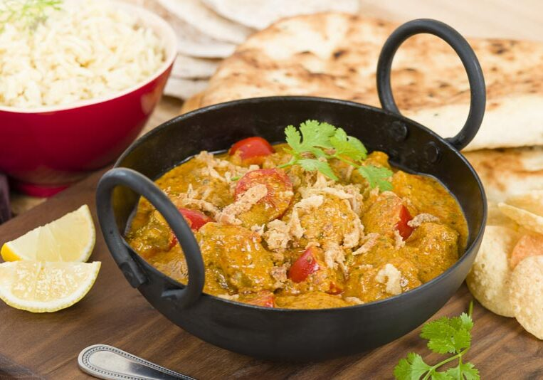 Karahi Gosht - Mutton curry cooked with tomatoes and topped with